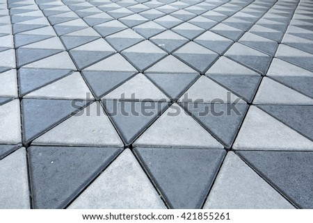 Brick flooring triangle rock tile background, triangle