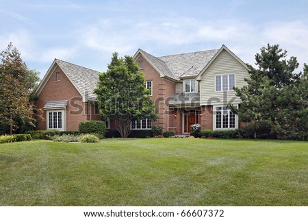 Brick home in suburbs with cedar roof