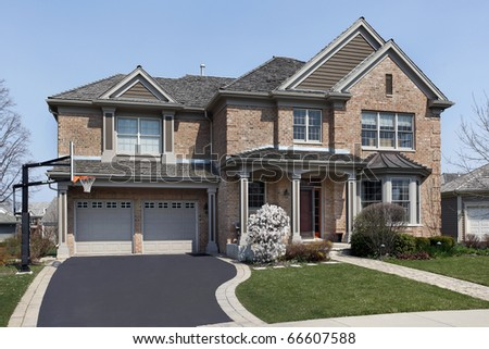 Brick home in suburbs with covered entry - stock photo