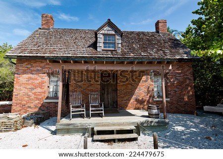 Brick home of lighthouse keeper at Cape Florida Bill Baggs State Park - stock photo