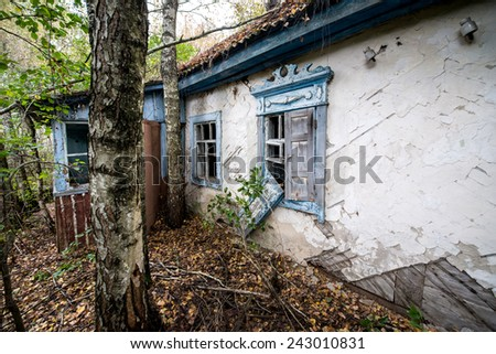 brick house in small abandoned village called Stechanka in Chernobyl Nuclear Power Plant Zone of Alienation, Ukraine - stock photo