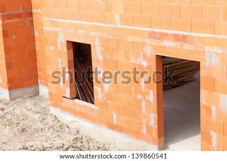 brick house under construction - stock photo