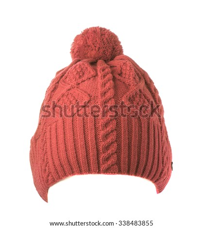 brick knitted hat with pompom isolated on white background . - stock photo