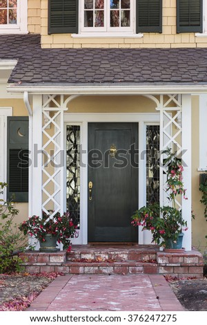 Brick lined pathway to front door with plants