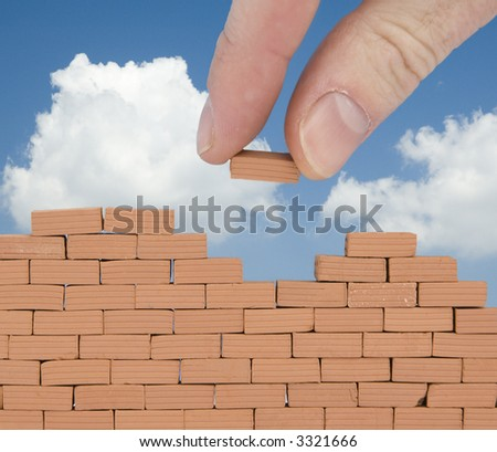 brick on the wall with sky - stock photo