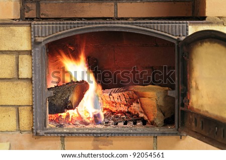 Brick oven with the door open and burning the wood