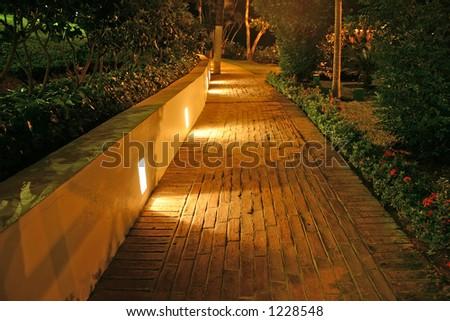 Brick path walkway at night - stock photo