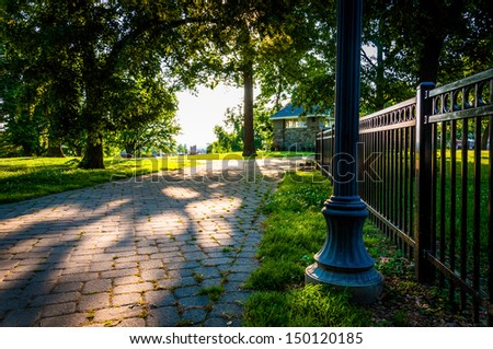 Brick pathway and fence in Federal Hill Park, Baltimore, Maryland. - stock photo