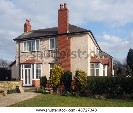 Brick & Render detached house in UK - stock photo