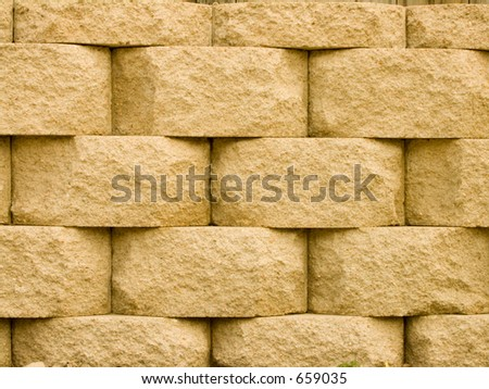 Brick retaining wall  in basket weave pattern. - stock photo