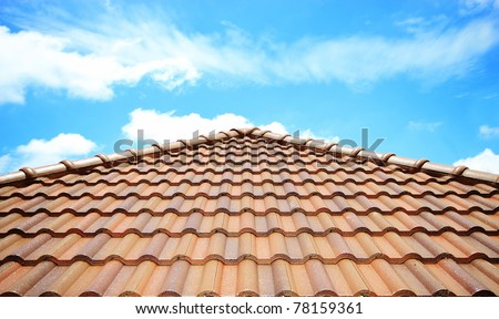 brick roof with clear cloud blue sky - stock photo