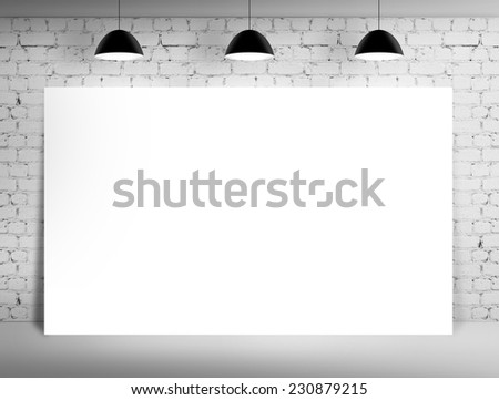 brick room with white poster on wall - stock photo