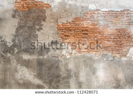 brick rough plaster cement partial crack wall - stock photo