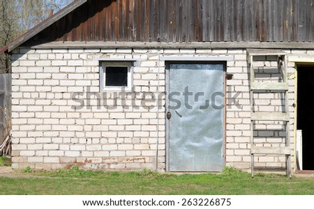 brick shed with door and window - stock photo