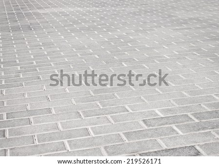 Brick stone street road. Light pavement texture - stock photo