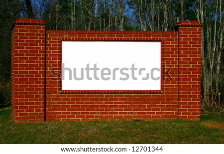 Brick structure with white sign background - stock photo
