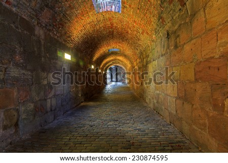 Brick tunnel with light in the end  - stock photo