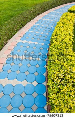 Brick walkway in garden - stock photo