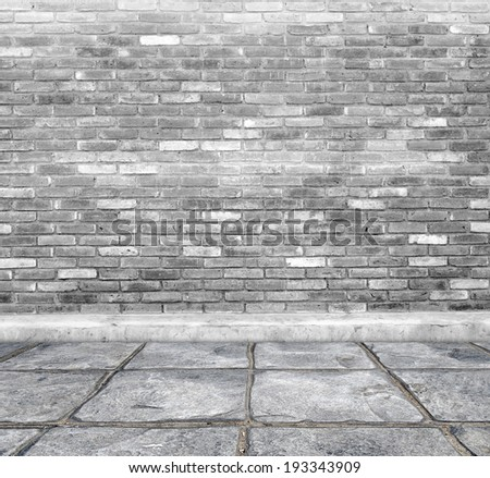Brick wall and concrete footpath in perspective.