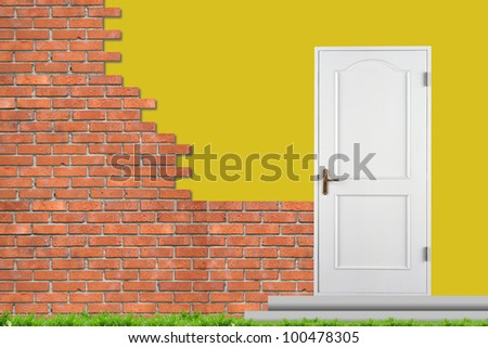 Brick wall and white closed doors. The unfinished house