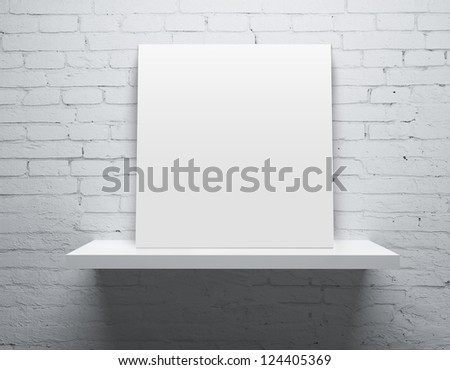 brick wall and white shelf with poster - stock photo