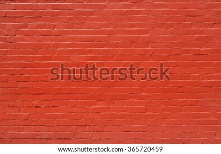 Brick wall background - an old brick wall with lots of character painted burnt orange color. Ideal urban modeling background for fashion or pop music industry. Also ideal background for sign; poster. - stock photo