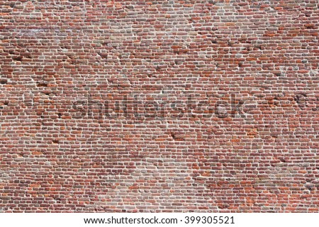 Brick wall background - old aged red bricks. - stock photo