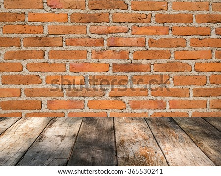 brick wall background on wooden floor
