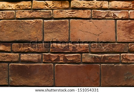 Brick Wall Background / Wall for background texture with damaged brown bricks - stock photo