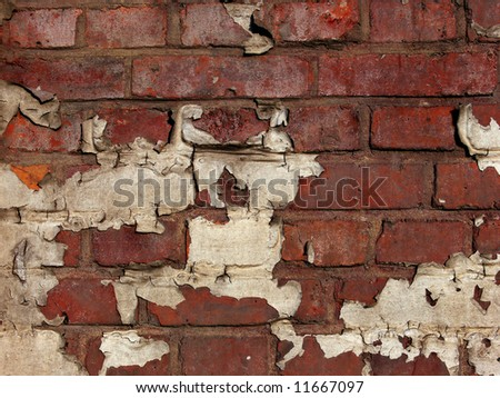 Brick wall background with old paint - stock photo