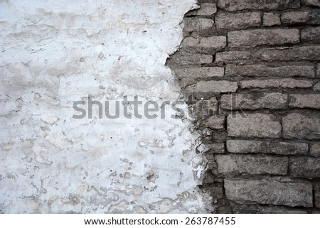 Brick wall background with stucco - stock photo