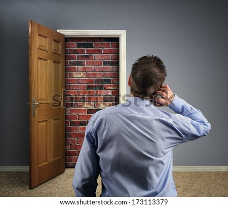Brick wall blocking the office doorway for a businessman concept for conquering adversity, business obstacle trapped or no way out - stock photo