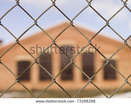 Brick Wall building behind a fence