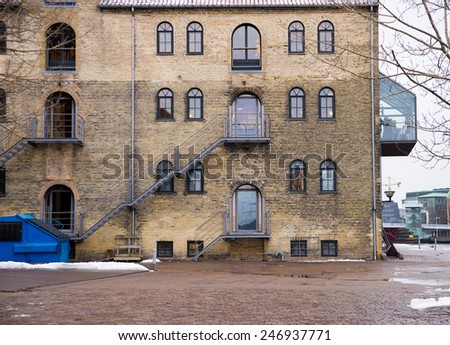 brick wall building with windows - stock photo