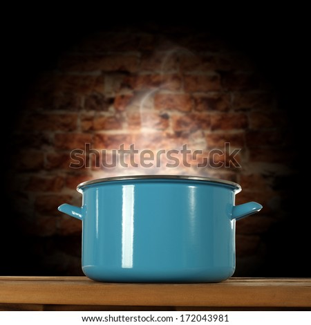 brick wall in kitchen and empty warm pot  - stock photo