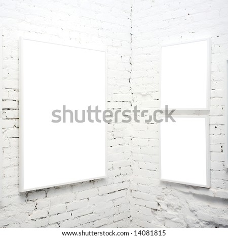 brick wall in museum with empty frames - stock photo