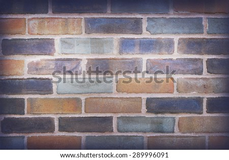 brick wall in orange and blue colors, trendy urban wall background
