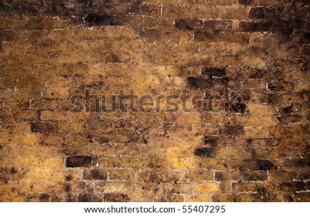 Brick wall inside of an old wine cellar as background - stock photo