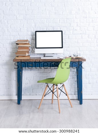 brick wall interior work desk and green chair  - stock photo