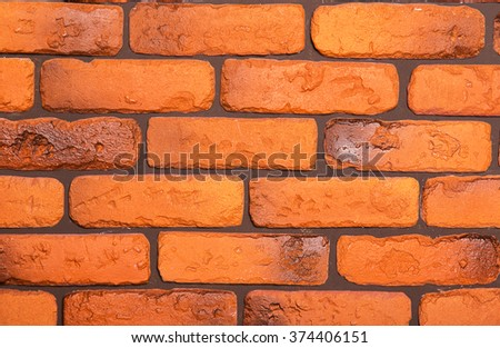 Brick wall made of red bricks in the room - stock photo