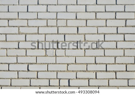 Brick wall made of white silicate bricks on cement-lime mortar. Eleven full series.