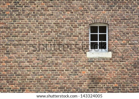 brick wall of old castle with window - stock photo