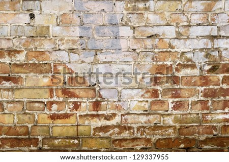 Brick Wall. Old Dark Red Bricks with Cracks and Dirt Spots.
