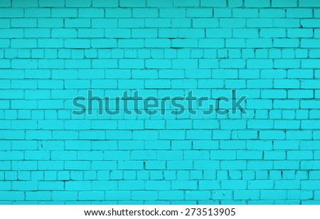 Brick wall painted in bright turquoise color. The texture of the brickwork. - stock photo