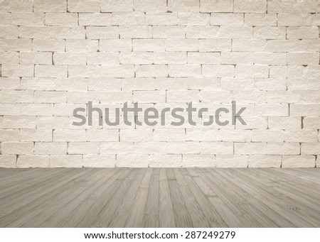 Brick wall painted in light sepia cream beige color tone with wooden floor textured background in dark grey color tone