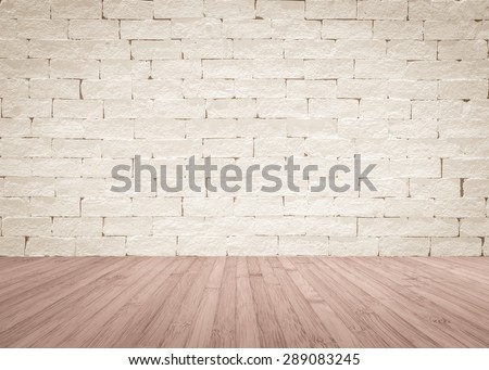 Brick wall painted in light sepia cream beige color tone  with wooden floor textured background in red brown color tone  - stock photo