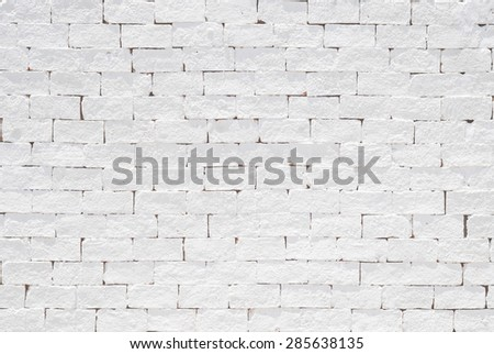 Brick wall pattern texture background painted in light white color tone: Empty masonry wall textured backdrop in white colour - stock photo