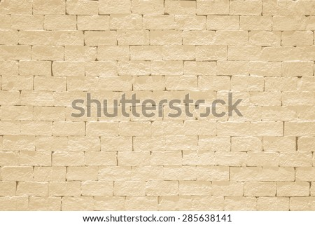 Brick wall pattern texture background painted in light yellow beige color tone: Empty masonry wall textured backdrop in yellow beige colour  - stock photo