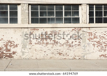 brick wall sidewalk windows - stock photo