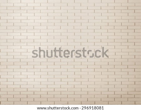Brick wall tile texture background painted in antique sepia white color tone:Tiled brick wall in light sepia beige cream white tone     - stock photo